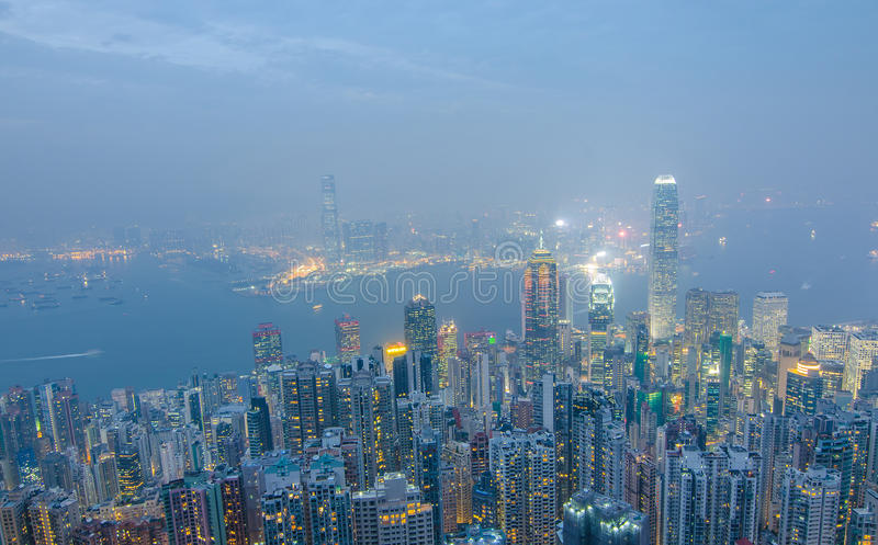 Hong Kong the scenes, victoria harbour from the peak bird view,. In the mist with bad weather in the night, nimbus landscape on the trails stock image