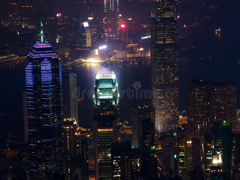 Hong Kong the scenes, victoria harbour from the peak bird view, in the mist with bad weather in the night, nimbus landscape on the. Trails stock image