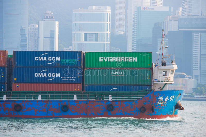 Hong Kong - September 23, 2016 :Container ship in Victoria harbor at Hong Kong Island. Landmark royalty free stock photo