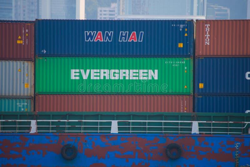 Hong Kong - September 23, 2016 :Container ship in Victoria harbor at Hong Kong Island. Landmark stock photography