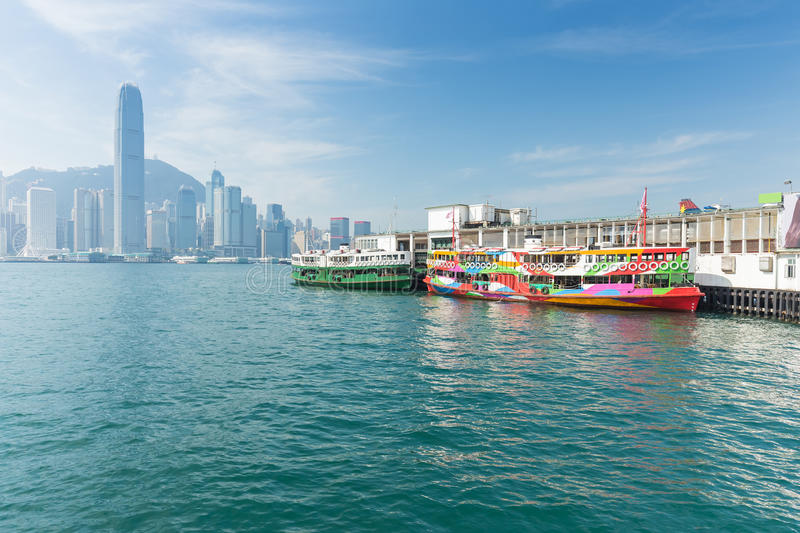 Hong Kong skyline with boats in Victoria Harbor.  royalty free stock photos