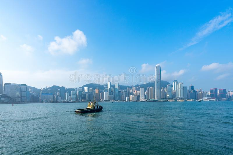 Hong Kong skyline cityscape at Victoria Harbor. Hong Kong skyline cityscape,  boat at Victoria Harbor in morning royalty free stock photo