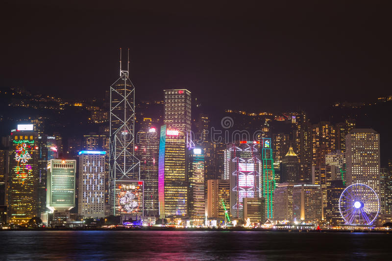 Hong Kong skyline at night from across Victoria Harbor. HONG KONG - January 25, 2016: Hong Kong skyline at night from across Victoria Harbor stock image