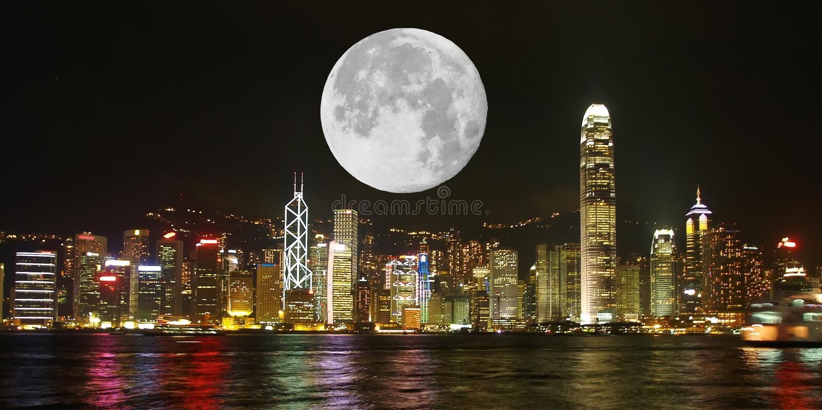 The Hong Kong Skyline and super moon. Hong Kong Skyline at night stock photo