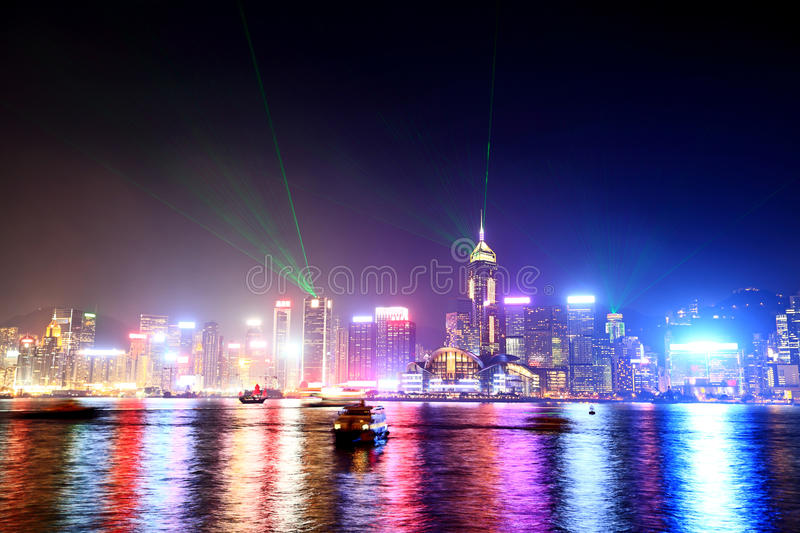 Hong Kong skyline and Victoria harbor from Kowloon. With colorful city lights at night stock photos