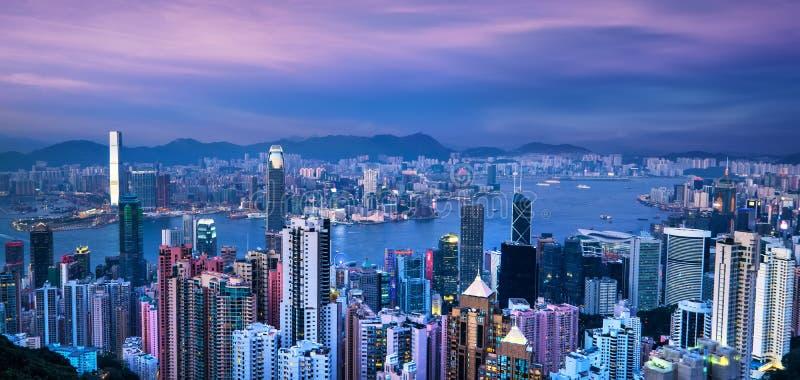 Hong Kong skyline and Victoria Harbor at sunset stock photo