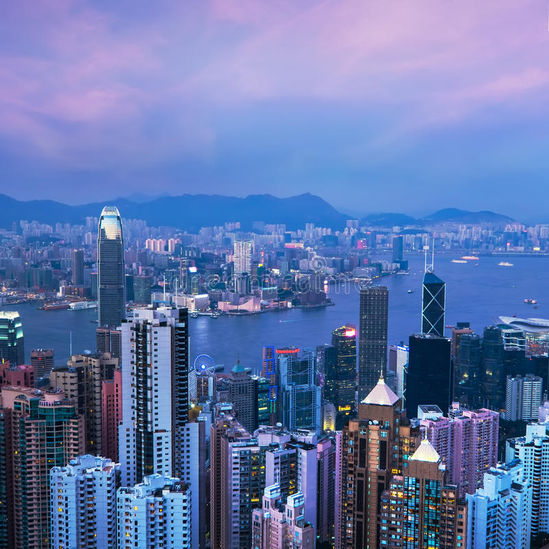 Hong Kong skyline and Victoria Harbor at sunset. Aerial view of Hong Kong skyline and Victoria Harbor at sunset. Travel destinations royalty free stock images
