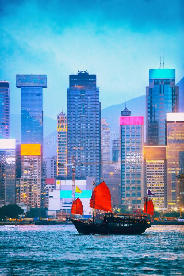 Hong Kong skyline view at dusk of Victoria Harbour from the Tsim Sha Tsui side with neon signs lit up in the night. Nightlife view stock photo