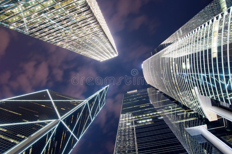Hong Kong Skyscrapers. A bottom up view of Hong Kong skyscrapers at night in the central business district on Hong Kong Island. The building in the lower left royalty free stock images