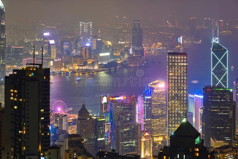 Hong Kong skyscrapers skyline cityscape view. Famous view of Hong Kong - Hong Kong skyscrapers skyline cityscape view from Victoria Peak illuminated in the stock photography