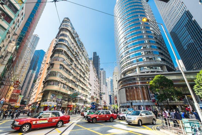 Hong Kong stad med skyskrapor och taxitaxin arkivfoton
