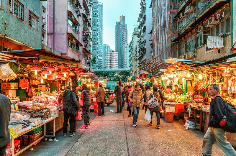 Hong Kong street market abounds with different sorts of ripe fresh fruit and other food. Evening view of Hong Kong street market. royalty free stock photography