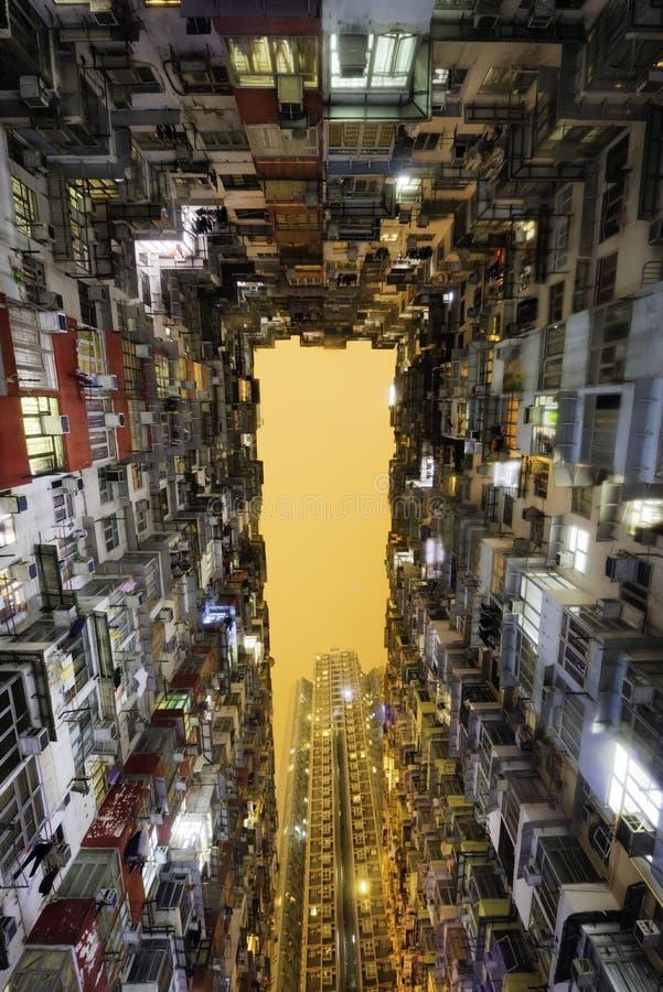 Hong Kong street scene at night. Hong Kong tenement apartments at night stock photography