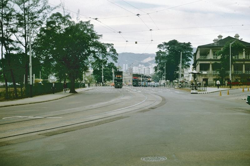1965 Hong Kong street scene with trolley cars. December 1966 Hong Know street scene with trolley cars and overhead power lines royalty free stock photos