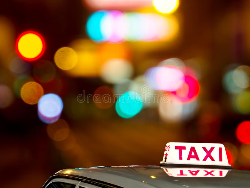 Hong Kong taxi sign with light bokeh stock photo