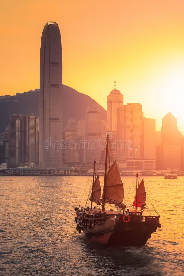 Hong Kong traditional tourists boat in victoria harbor. Hong Kong traditional tourists boat for tourist service in victoria harbor with city view in background royalty free stock photo