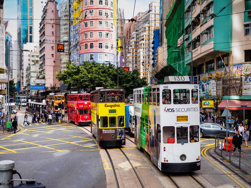 Hong Kong Tramways 'Ding Ding' double-decker trams. A colorful street photo showing the double-decker trams on Hong Kong Island, locally known as ' royalty free stock image