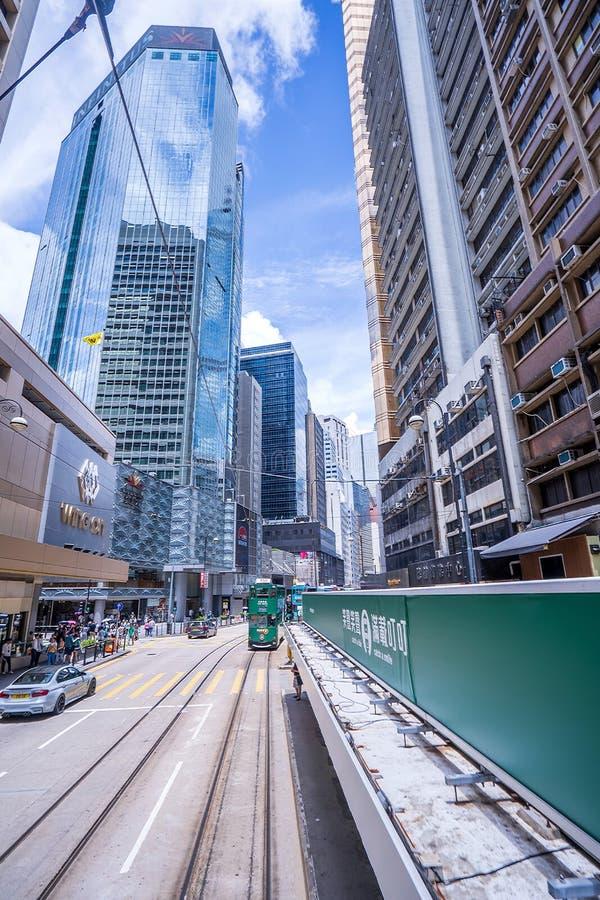 Hong Kong tramways, Hong Kong`s trams run in two directions -- east and west. Passengers lean back as a Hong Kong tram royalty free stock photo