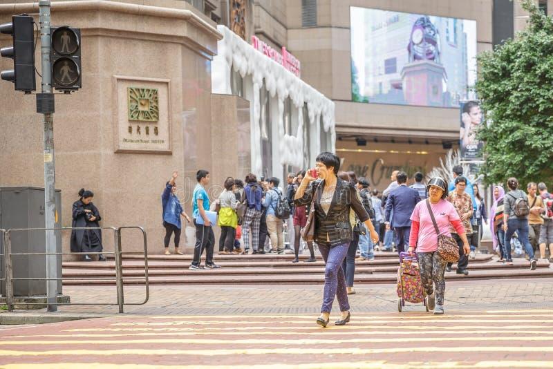 Hong Kong upptagen kvinna fotografering för bildbyråer