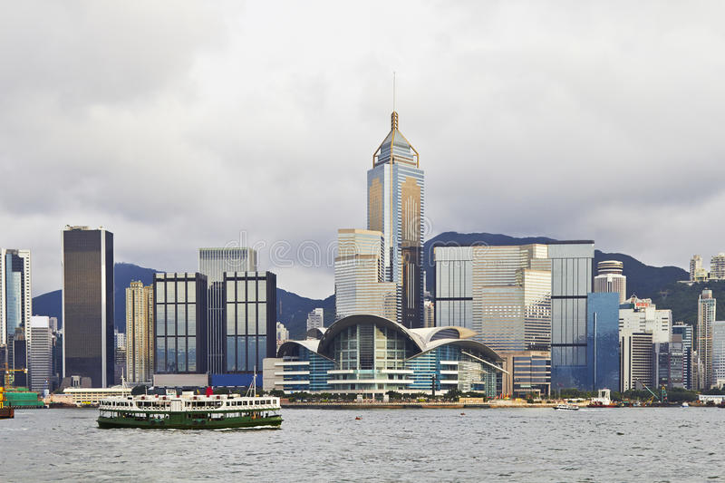 Hong Kong, Victoria harbor with a ferry. A ferry crosses Hong Kong harbor in front of the skyline royalty free stock photography