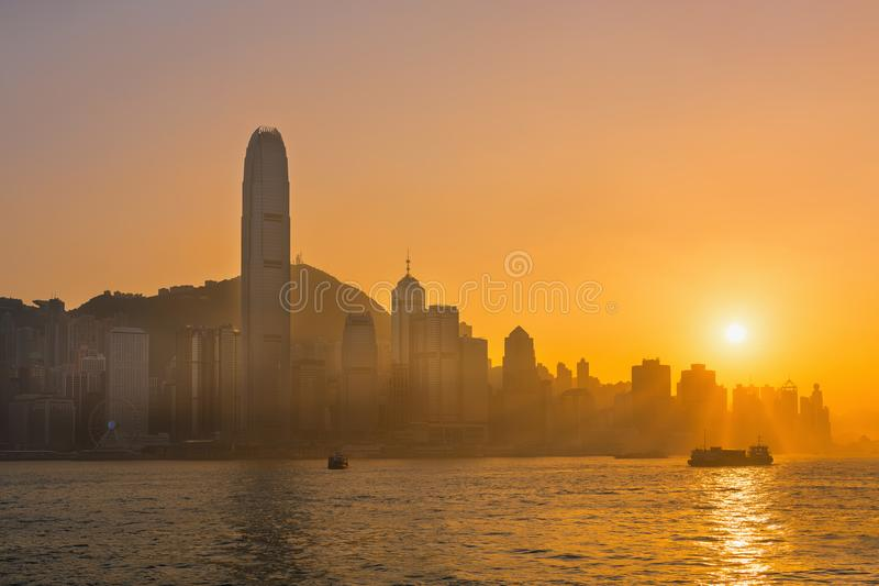 Hong Kong victoria harbor at golden hour of sunset scene.  royalty free stock image