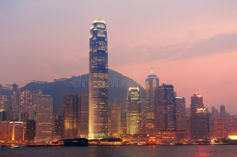 Hong Kong Victoria Harbor morning. With urban skyscrapers over sea lit with reflections stock image