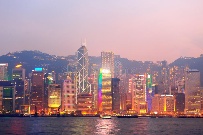 Hong Kong Victoria Harbor morning. With urban skyscrapers over sea lit with reflections stock photography