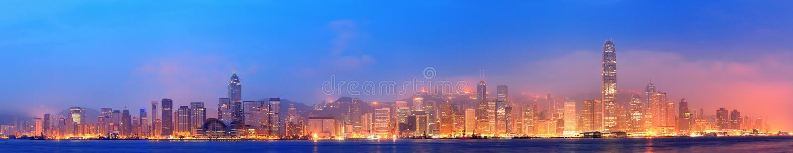 Hong Kong Victoria Harbor panorama. Hong Kong Victoria Harbor morning with urban skyscrapers over sea with blue tone and street light stock photo