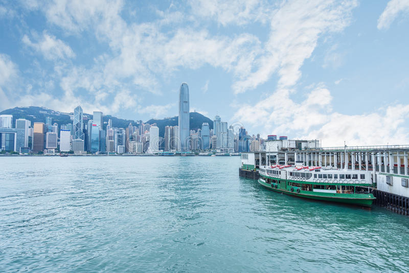 Hong Kong victoria harbor skyline and ferry pier. China stock images