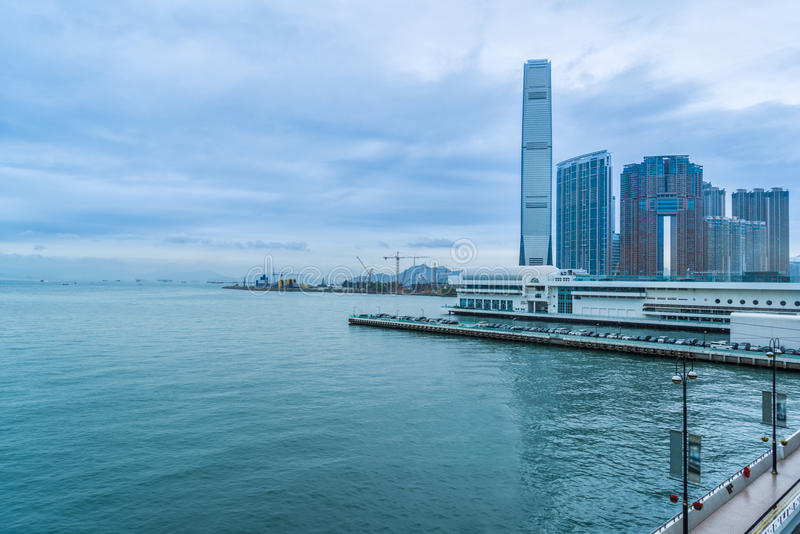 Hong Kong victoria harbor skyline and ferry pier. China royalty free stock photography