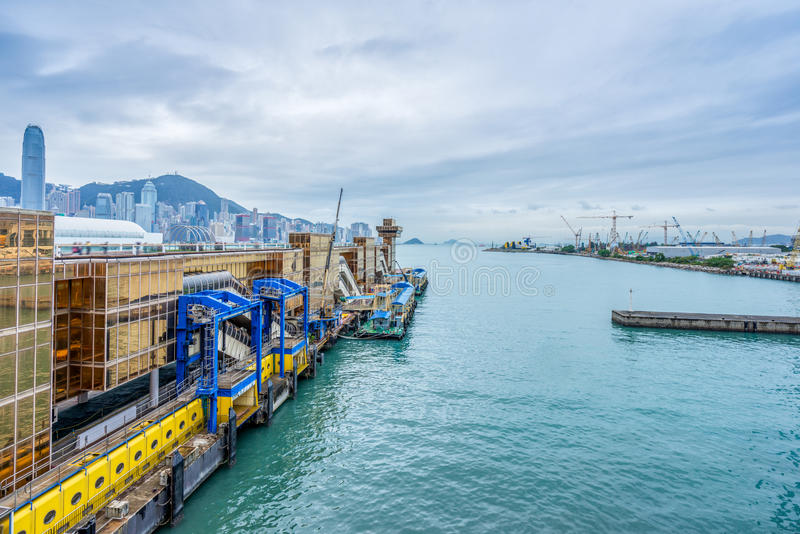 Hong Kong victoria harbor skyline and ferry pier. China stock photo
