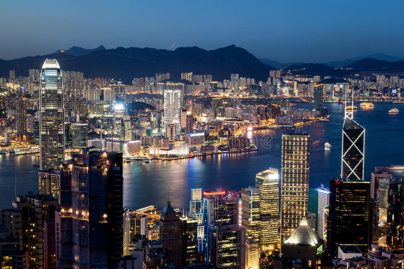 Hong Kong Victoria Harbor Skyline at Night. Colorful night scene of Victoria Harbor in Hong Kong just after sunset at the blue hour. Shot taken at Victoria Peak royalty free stock photography