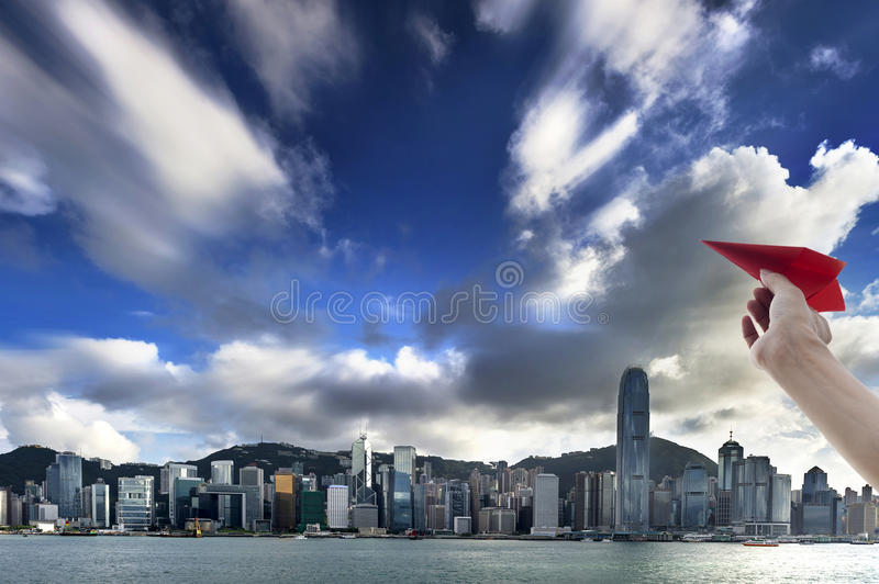 Hong Kong view of Victoria Harbor,. The paper airplane and Hong Kong Island business district royalty free stock photo