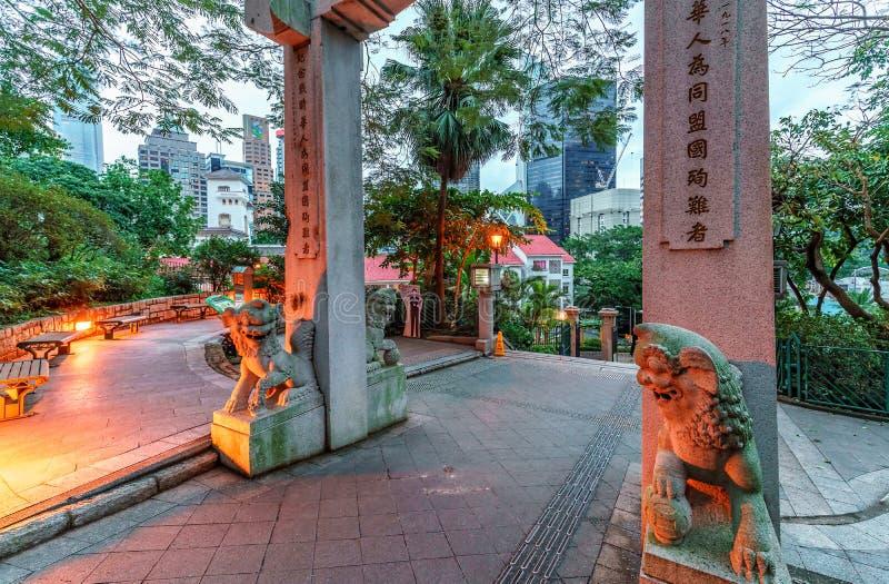 Hong Kong Zoologiczny i ogródy botaniczni w Środkowym okręgu Wejście łuk z lew rzeźbami fotografia stock