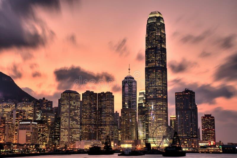 Hong- KongSkyline am Sonnenuntergang lizenzfreie stockfotos