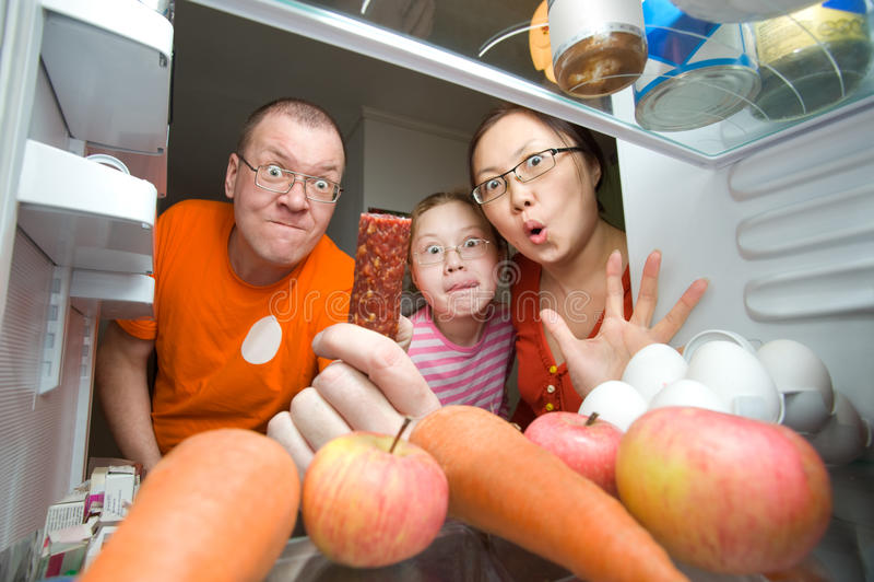 Hongerige familie stock fotografie