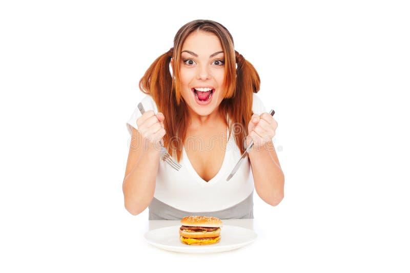 Hongerige vrouw met hamburger royalty-vrije stock afbeelding