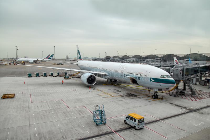 Hongkong airport,hongkong-December 6,2018: Plane cathay pacific airline stop in gate hongkong international airport at hongkong royalty free stock image