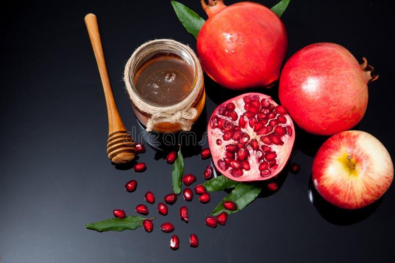 Honig, Apfel und Granatapfel für traditionellen Feiertag ha stockfotografie