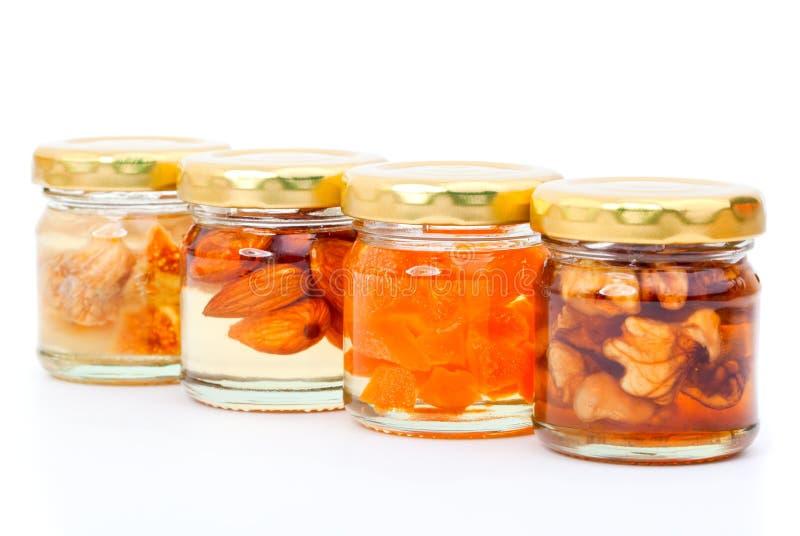 Honig der Feigen, Mutter, Aprikose in Büchsen konserviert lizenzfreies stockfoto