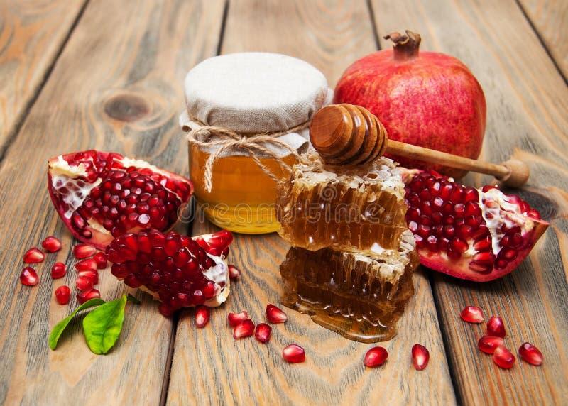 Honig mit Granatapfel lizenzfreie stockfotografie