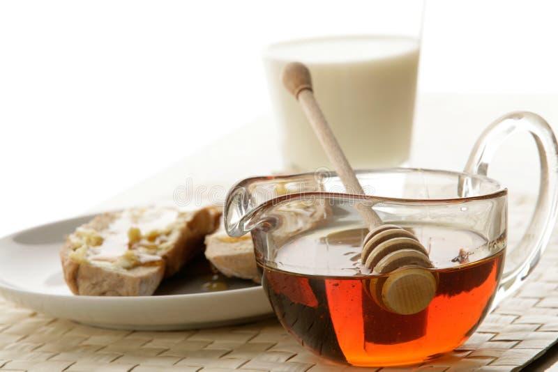 Honig und Milch lizenzfreie stockbilder