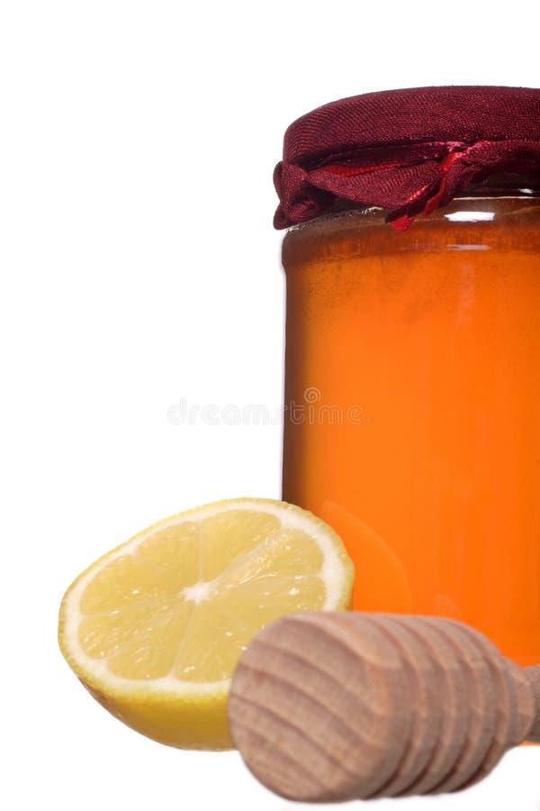 Honig und Zitrone stockbilder