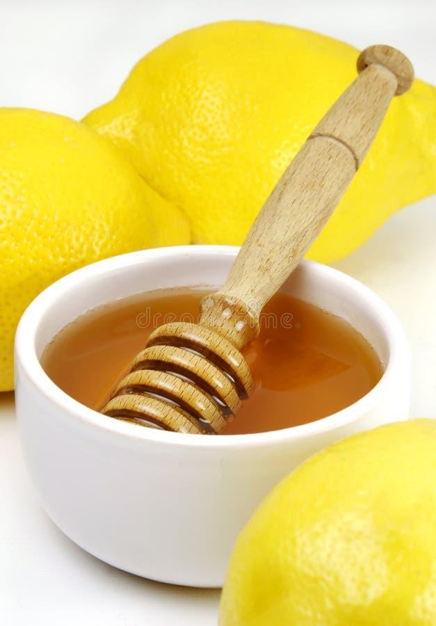 Honig und Zitronen lizenzfreie stockbilder