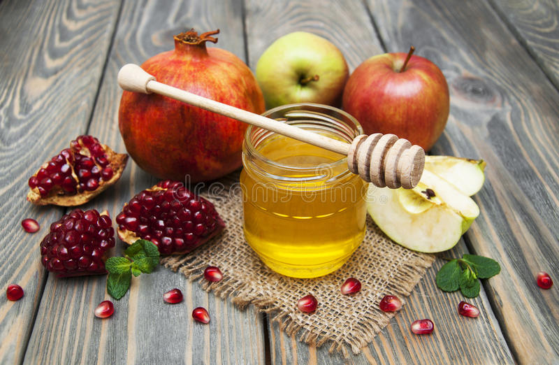 Honigapfel und -granatapfel stockfotos