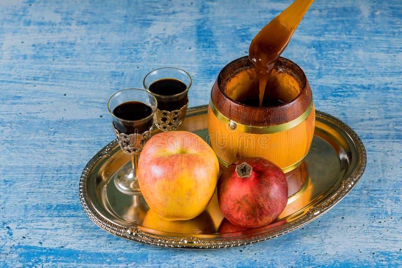 Honigglas mit Hebr?erreligi?sem feiertag ?pfel Rosh Hashana stockfotos