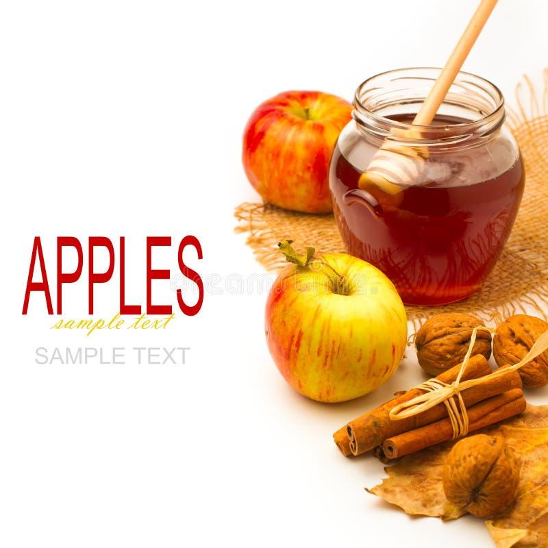 Honigglas und -äpfel stockfotos
