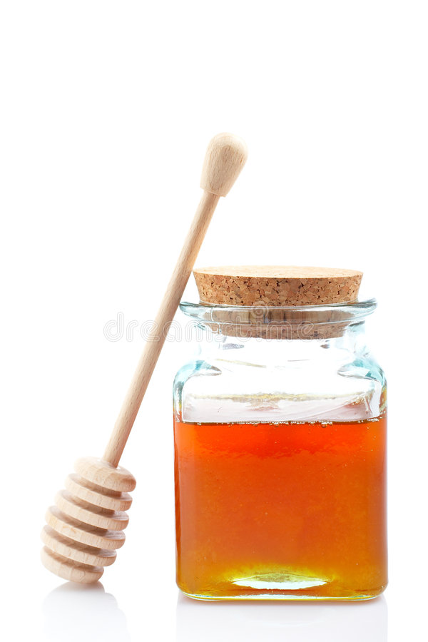 Honigglas und hölzernes drizzler stockfoto