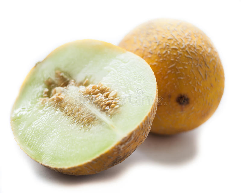 Honigmelone lokalisiert auf Weiß stockbild