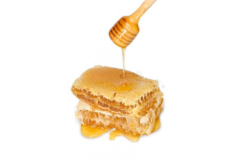 Honigwabe und Honigtropfen auf weißem Grund isoliert mit Klippenweg stockfotos